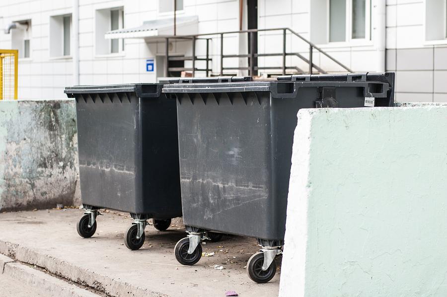 black garbage bins near housing